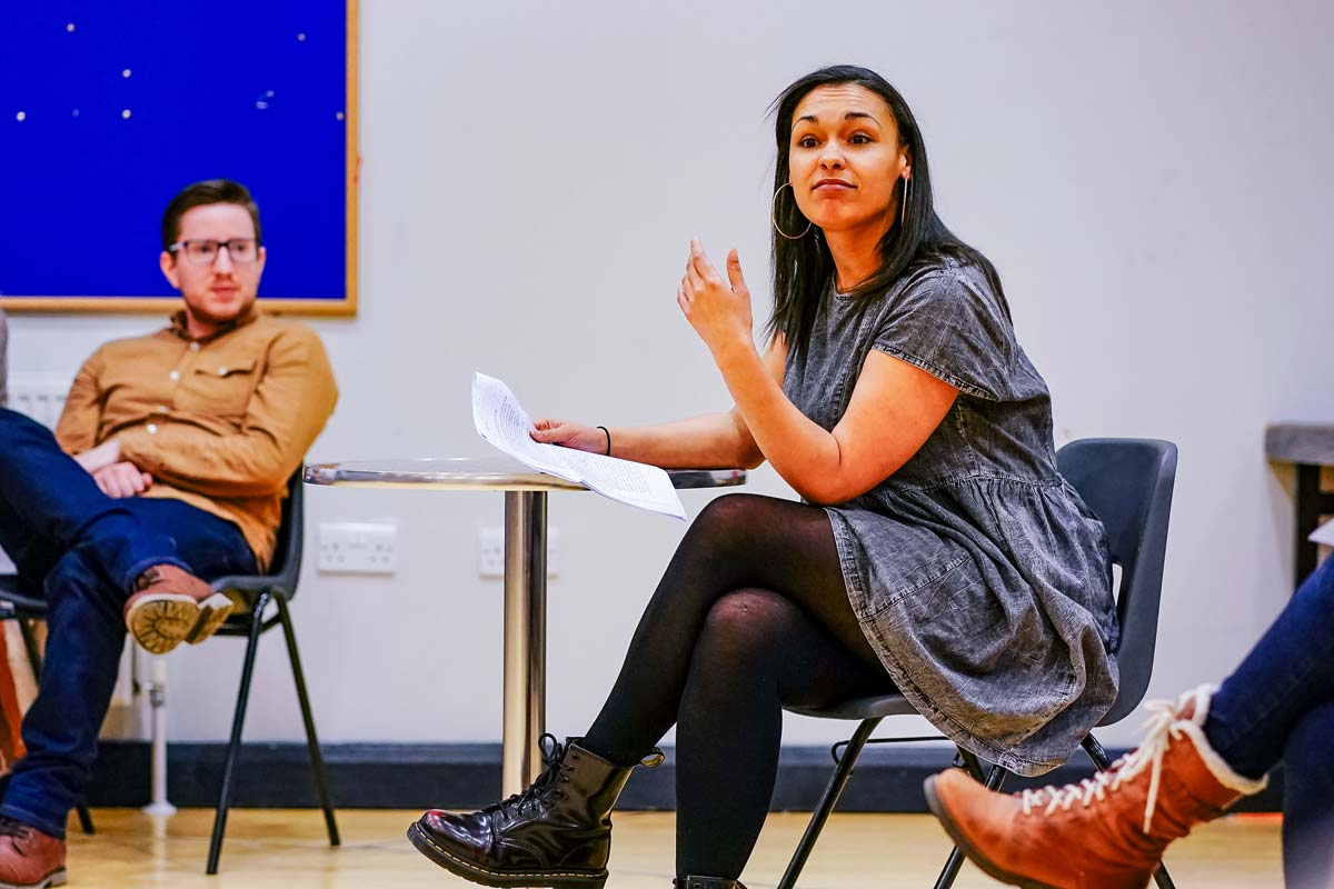 A young, black woman leads a theatre-making workshop